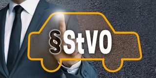 StVO auto touchscreen is operated by businessman concept
